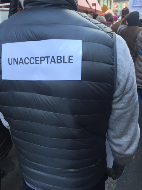 person with sign taped to his back